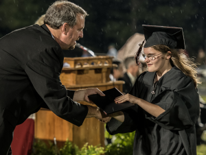 Girl with CHARGE receiving her high school diploma