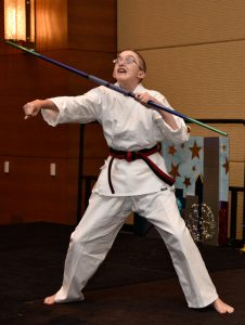 a boy with CHARGE demonstrates some karate moves
