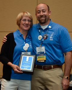 Donna Martin receiving her CHARGE recognition award from David Wolfe