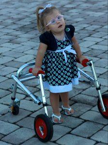 little girl in a dress using a kay walker