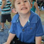 young boy using a walker